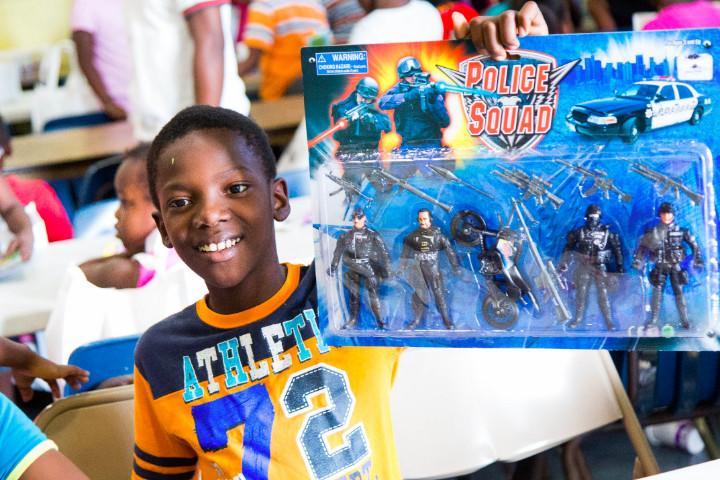 St._Andrew_s_Kirk_Children_s_Party_-_Boy_showcases_gift_received_1.jpg