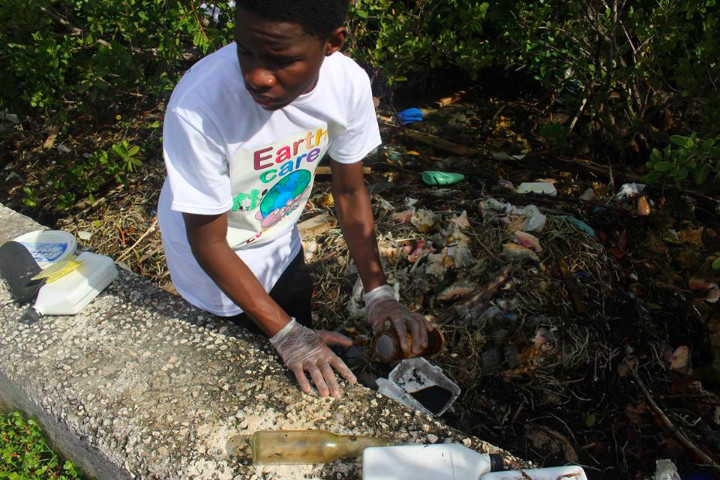 Tyler_Riley__EARTHCARE_Eco_Kids______Team_Leader_cleans_the_mangroves_on_World_Wetlands_Day.jpg