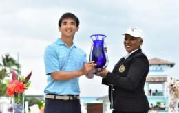 Zecheng_Dou_Accepts_Golf_Trophy_from_Min._of_Tourism_s_Eldece_Clarke_1.jpg