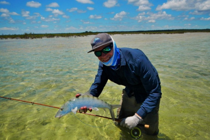 a_happy_angler_cuaght_a_fish_while_wading_in_the_flats_of_Andros.jpg
