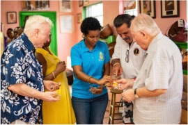 Andrica_Smith_Munroe_with_some_EAT_Bahamas_Food_Tour_guests_at_Mortimers_Candie_Kitchen-2.jpg