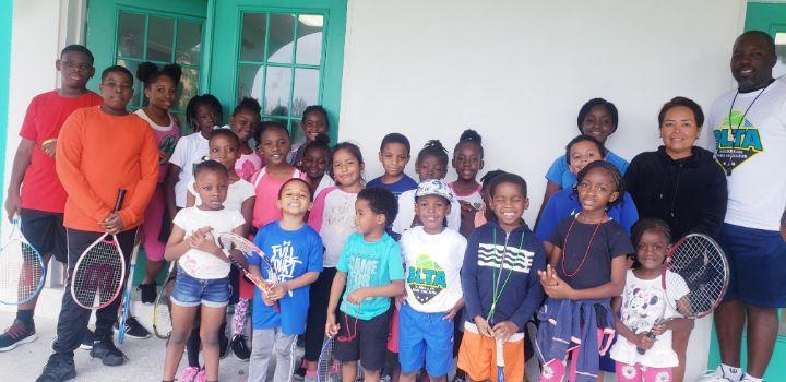 Coach_Newton_and_Coach_Rita__with_the_kids.jpg