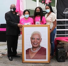 Director_General_of_BIS_Kevin_Harris_Presents_Portrait_to_Family_of_the_late_Jennie_Mae_Johnson_McLeod_1.jpg