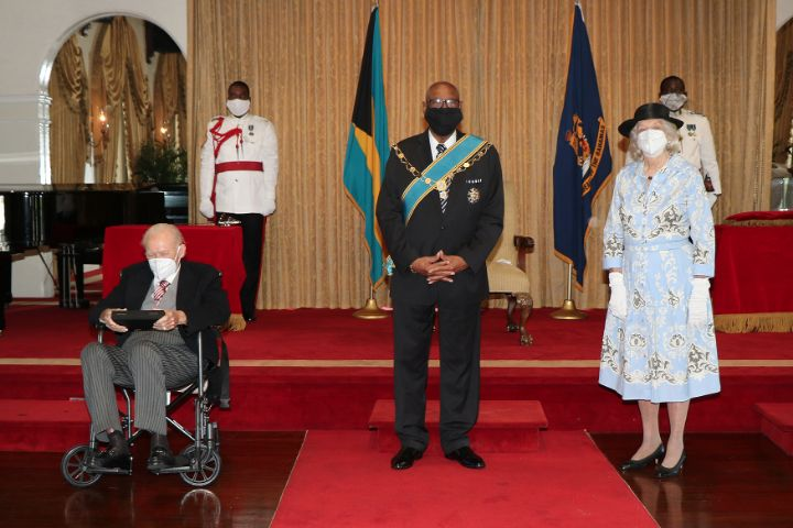Governor_General_HE_the_Most_Hon._Sir_Cornelius_A._Smith__centre__with_Sir_Godfrey_Kelly_and_Lady_Kelly.jpg