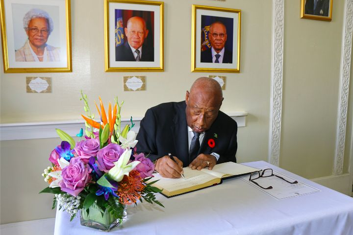 Governor_General_Signs_Book_of_Condolence_at_Lie-in-State_of_Former_Senator_Dr._Calsey_Johnson.jpg