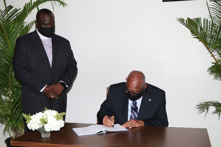 Governor_General_Signs_Book_of_Condolence_for_Late_Pastor_Hugh_Roach.jpg