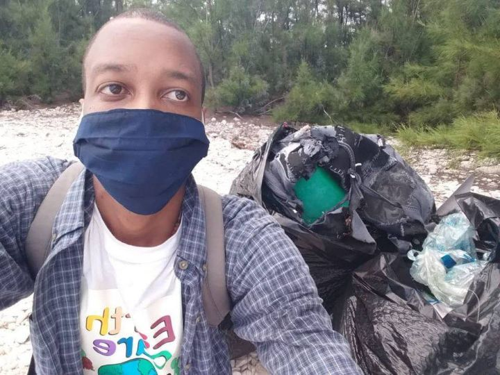Jahrin_Ellis__EARTHCARE_member_with___________his_ICC_Day_haul_of_Marine_Debris_from_Lovers_Beach.jpg