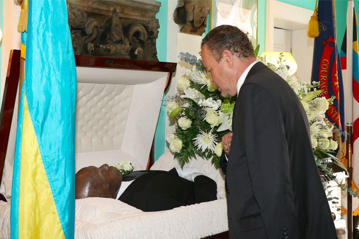 Minister_Carl_Bethel_pays_respects_to_Edward__Bobby__Glinton.jpg
