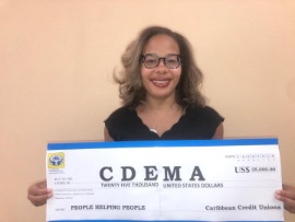 Ms_Denise_Garfield_-_CCCU_with_Cheque_donation_to_CDEMA-2-2.jpg