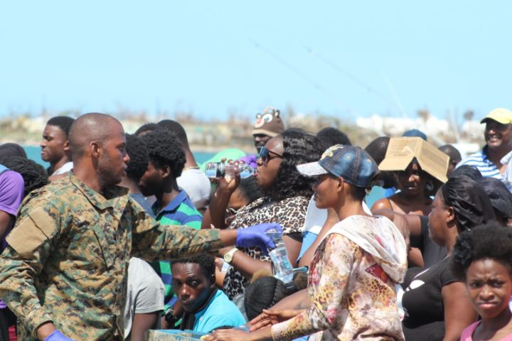 Ph_11_-_Marine_Seaman_Livingston_Munroe_assists_Abaco_residents_in_Marsh_Harbour_Abaco_following_the_passage_of_Hurricane_Dorian.jpg