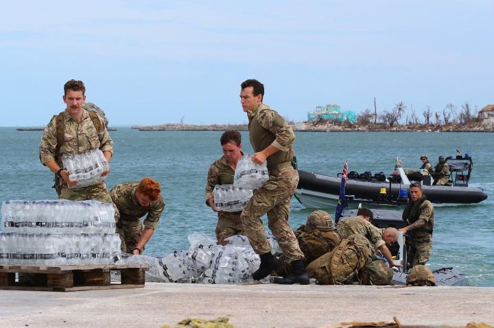 Ph_14_-_Officers_from_the_British_naval_Ship_off_load_water_for_distribution_on_Wednesday_following_the_storm_1.jpg