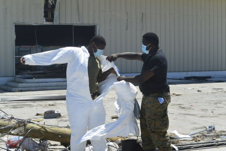 Ph_3_-_RBDF_Marines_putting_on_protective_gears_to_begin_search_and_resuce_efforts_in_Marsh_Harbour_Abaco_following_the_passage_of_Hurricane_Dorian.jpg