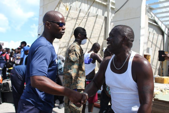 Ph_7_-_A_local_resident_of_Abaco_thanks_Sr._Lt_William_Sturrup_for_render_assitance_in_the_aftermath_of_Hurricane_Dorian_1.jpg