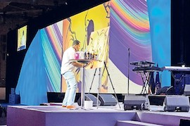 Photo_1_Jamaal_Rolle_Painting_on_Stage_at_Rotary_Hamburg_Convention_.jpg