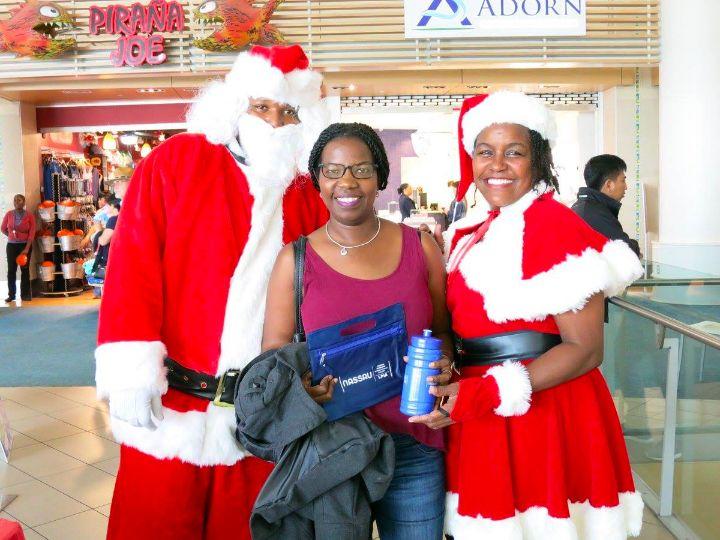 Photo_2-_Santa_and_his_helpers_bring_holiday_cheer_to_LPIA_passengers.jpg