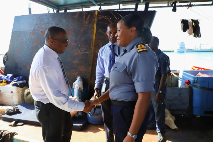 Photo_3_-_Minister_of_Agriculture_and_Marine_Resources__the_Hon._Michael_Pintard_and_Senior_Lieutenant_Samantha_Hart__Commanding_Officer_HMBS_Cascarilla_Inspecting_Dominican_Poachers_Vessel_1.jpg