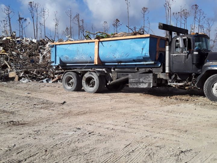Photo_4-_Workers_at_Spring_City_debris_management_site_process_approximately_185___200_truckloads_of_debris_daily_1_.jpg