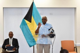 Prime_Minister_Minnis__at_podium___and_Mr._Lewis_1_-2-2.jpg