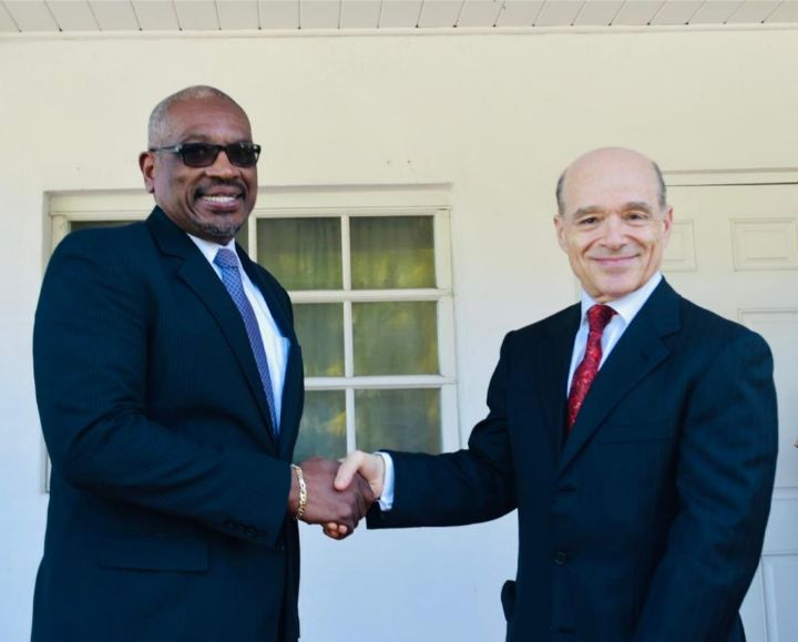 Prime_Minister_Minnis__left__in_handshake_with_Tyrsoz_Family_Holdings_Ltd._Representative_Ronnie_Ben-Zur.jpg