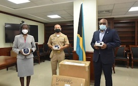 Prime_Minister_Minnis__right__US_Embassy_s_Commander_Kevin_Self__and_Acting_Permanent_Secretary__Ministry_of_Health_Pernell_King-Rolle_1.jpg