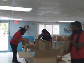 Salvation_Army_Teammembers_putting_together_care_packages_2_3.jpg