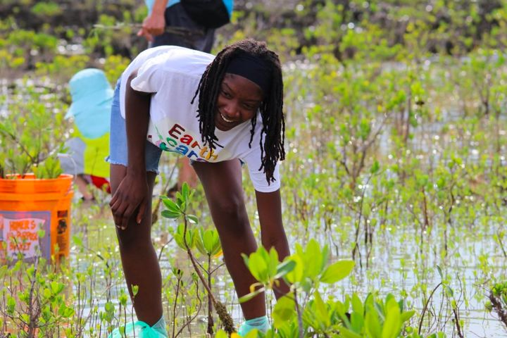 Shakada_Hutson__EARTHCARE_Eco_Kid______planting_mangroves_alongside_groups_from_China_and_The_Bahamas_.jpg