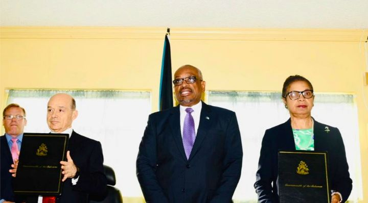 Signing_of_HOA_for_South_Abaco_-_Ronnie_Ben-Zur__Prime_Minister_Minnis__and_Camille_Johnson_.jpg