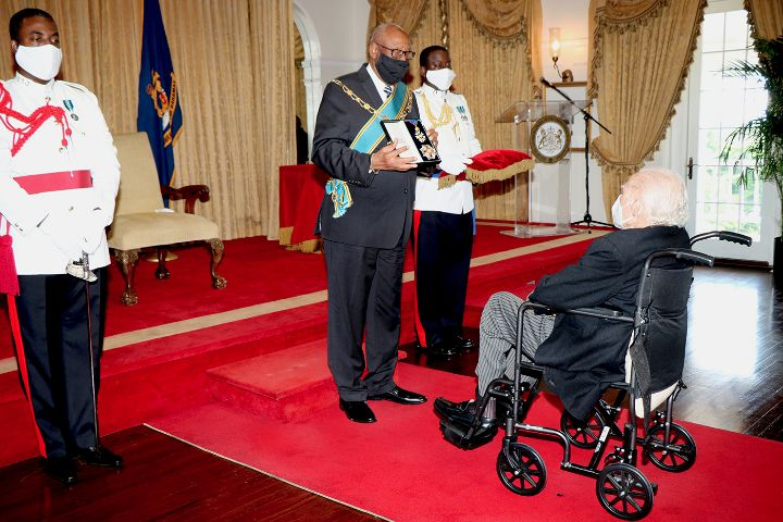 Sir_Godfrey__seated__Presented_with_Insignia_at_His_Investiture_Ceremony_at_Government_House_-_September_28__2020.jpg