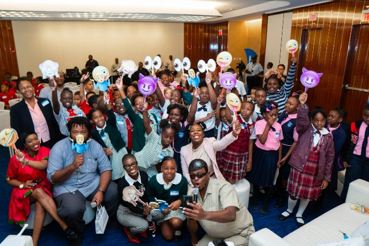 Students_from_Gambier_Primary__Eva_Hilton_Primary__Thelma_Gibson_Primary__Garvin_Tynes_Primary_and_Queen_s_College_takes_a_selfie_with_our_panelists.jpg