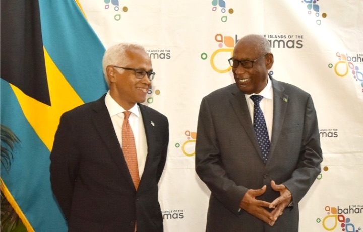 Tourism_Minister_D_Aguilar__left__and_Governor_General_C.A._Smith.jpg