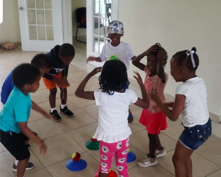 Young_kids_enjoying_tennis_time.jpg
