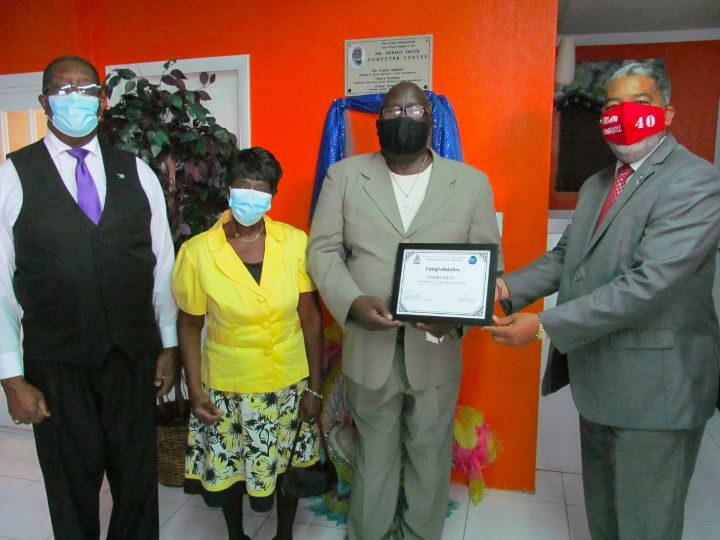9450_-_Honouree_Kermit_Smith_Receives_Certificate_from_Minister_Campbell.jpg