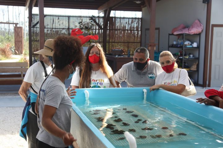 Allannah_Vellacott__Coral_______Restoration_Specialist_explaining_the_Coral_Micro-fragmentation__process____to___the_EARTHCARE_group.jpg