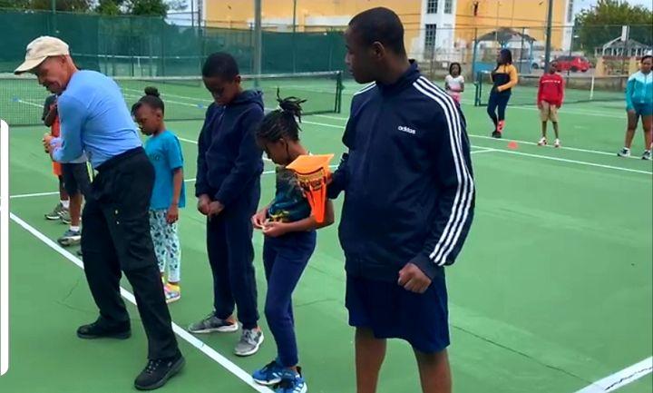 Barry_Usher_assists_in_Play_Tennis_program.jpg