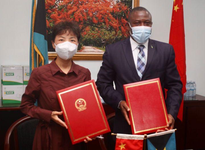 Chinese_Ambassador_Her_Excellency_Dai_Qingli_and_Minister_of_Health_Hon._Renward_Wellsjpg.jpg