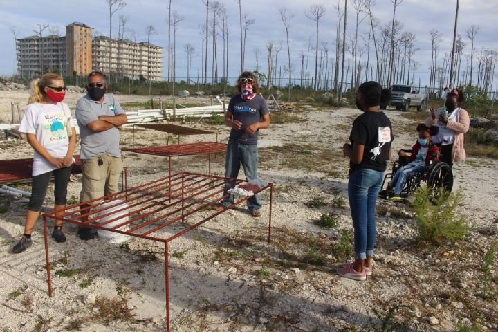 Coral_Vita_Director_of_Restoration_______Operations__Joe_Oliver_explains_the_Coral_Nursery_Tables.jpg