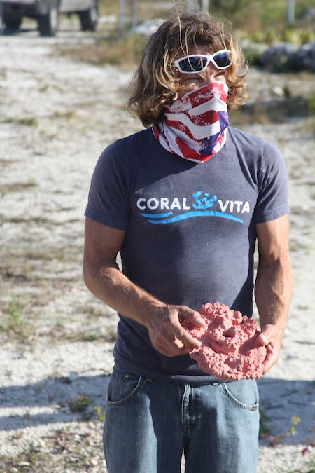 Coral_Vita_Director_of_Restoration_______Operations__Joe_Oliver_holds_a_hand_made_Coral_Nursery_Plate.jpg