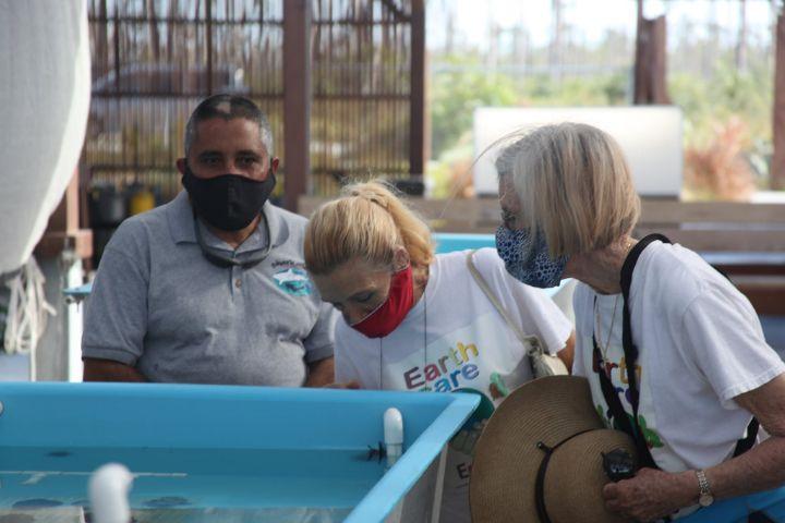EARTHCARE_Volunteers_look_on_as_____Allannah_Vellacott_explains_coral_restoration_processes.jpg