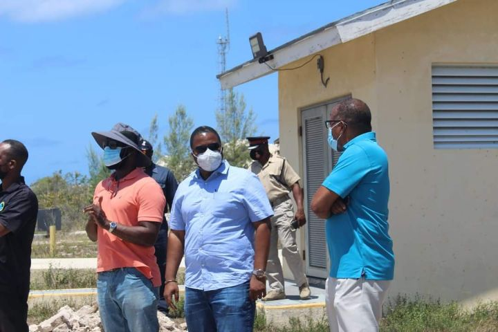 Inagua_-_WSC_Executive_Chairman_Adrian_Gibson__centre__and_GM_Elwood_Donaldson__right.jpg