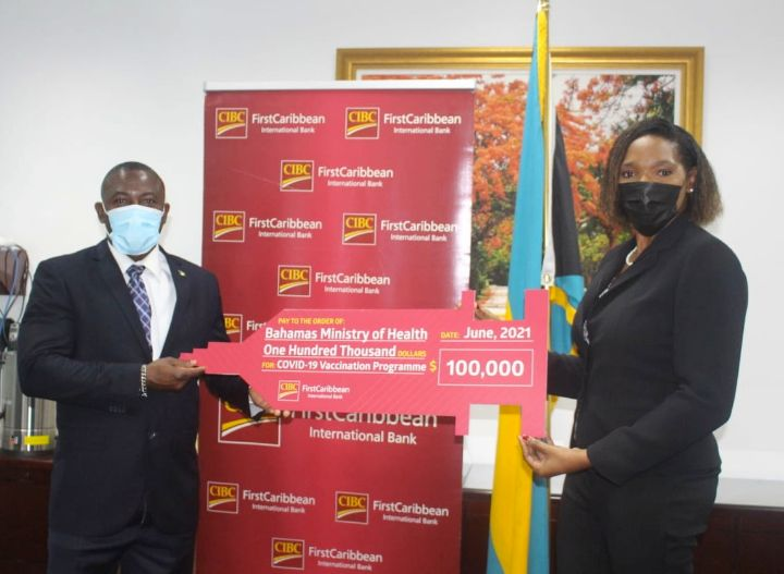 Minister_Wells_and_CIBC_FirstCaribbean_Managing_Director_Dr._Jacqui_Bend_1_.jpg