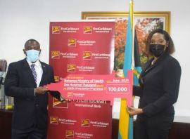 Minister_Wells_and_CIBC_FirstCaribbean_Managing_Director_Dr._Jacqui_Bend_1__1_.jpg