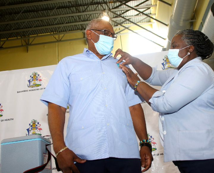 Prime_Minister_Minnis_receives_his_sticker_to_confirm_second_dose_of_Vaccne.jpg