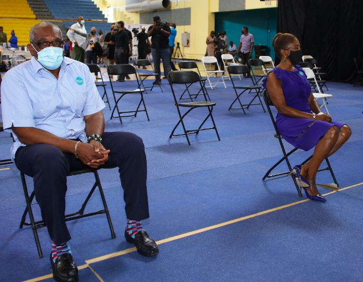Prime_Minister_and_Mrs_Minnis_wait_in_observation_area_after_second_dose_of_vaccine.jpg