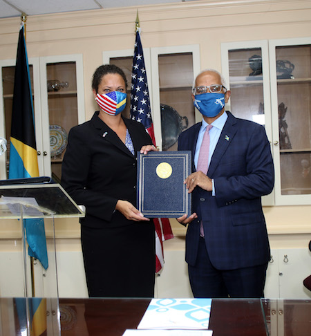 US_Charge_d_Affaires_Usha_Pitts_and_Minister_of_Tourism___Aviation_Dionisio_D_Aguilar_-_FAA_GOB_ANS_Agreement_-_May_5__2021_1__1_.jpg
