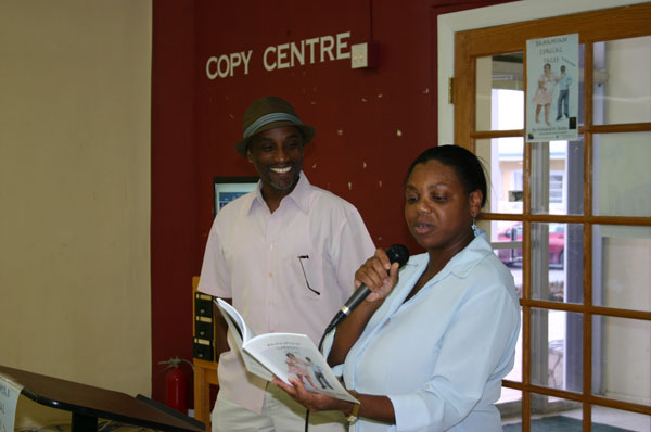 B-Ms_Pennerman_reading_one_of_KB_s_stories_during_launch_at_Sir_Charles_Hayward_Library_on_Friday_afternoon.jpg