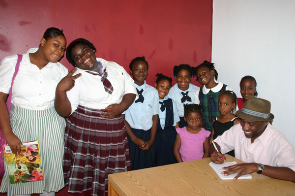 C-_KB_with_students-signing_books_at_the_launch_of_his_book_at_the_Sir_Charles_Hayward_Library_on_Friday_afternoon.jpg